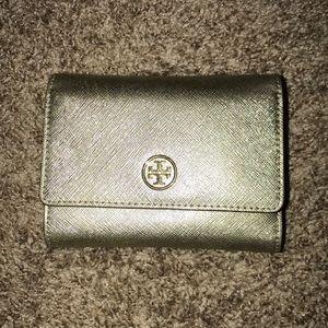 Gold Tory Burch tri-fold wallet